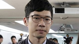 In this Jan. 27, 2018, file photo, pro-democracy activist Nathan Law attends a press conference in Hong Kong. He has now left the city for an undisclosed location.