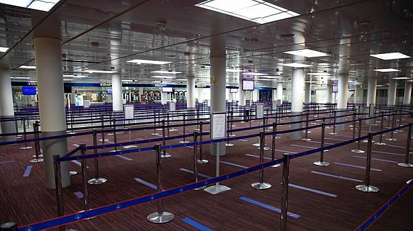 Empty halls in Terminal 2 of Charles de Gaulle international airport are pictured in Roissy, north of Paris, Thursday, May 14 2020.