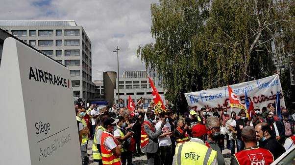 Air France workers gather during a protest in front of the company headquarters in Tremblay-en-France, outside Paris.
