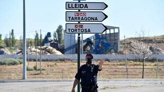A member of the Catalan regional police force Mossos d'Esquadra controls a checkpoint on the road leading to Lleida on July 4, 2020