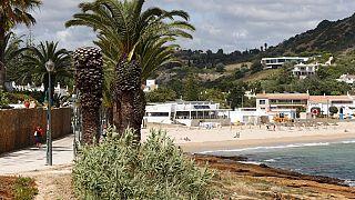 A view of the beach in Praia da Luz, in Portugal's Algarve coast, Thursday, June 4, 2020.