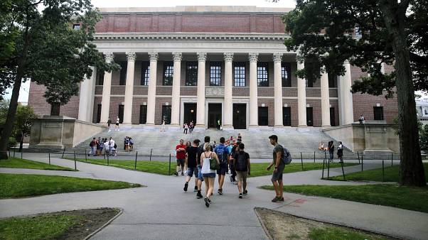 Students walk near the Widener Library in Harvard Yard at Harvard University in Cambridge, Mass. in August 2019.