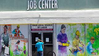 a person looks inside the closed doors of the Pasadena Community Job Center in Pasadena, Calif., during the coronavirus outbreak, May 7, 2020 (file)