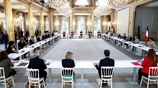 French President Emmanuel Macron (4th-R), Prime Minister Jean Castex (5th-L) and the new ministers at the first cabinet meeting after the government refshuffle, July 8, 2020.