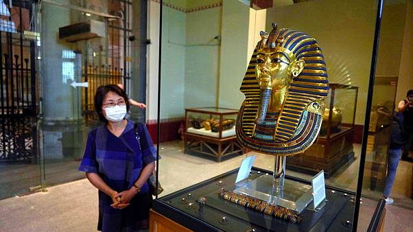 A Japanese tourist visits the golden mask of King Tut on display at the Egyptian Museum in downtown Cairo, Egypt
