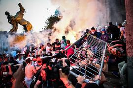 Protesters clash with police in front of Serbia's National Assembly building in Belgrade. July 8, 2020