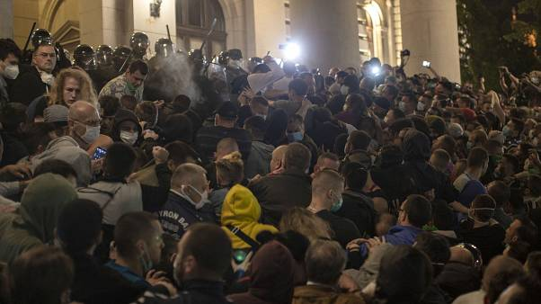 Upset with return of coronavirus curfew, protesters attempt to storm Serbian parliament