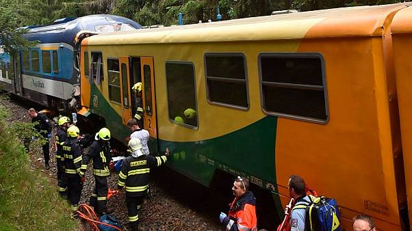 Emergency services at the scene after the two trains collided near the village of Pernink, Czech Republic.