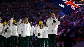 Alex Pullin of Australia carries the national flag as he leads the team during the opening ceremony of the 2014 Winter Olympics in Sochi, Russia