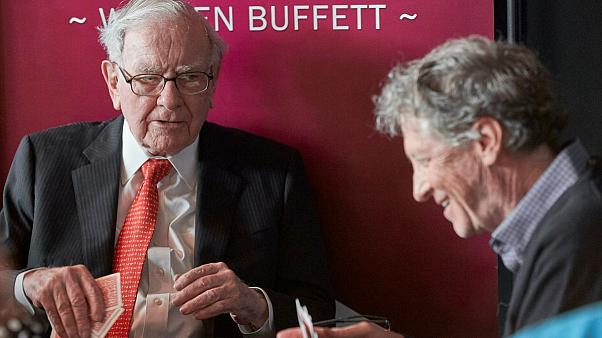 Warren Buffett, Chairman and CEO of Berkshire Hathaway, left, addresses Gill Gates, right, during a game of bridge following the annual Berkshire Hathaway shareholders meeting