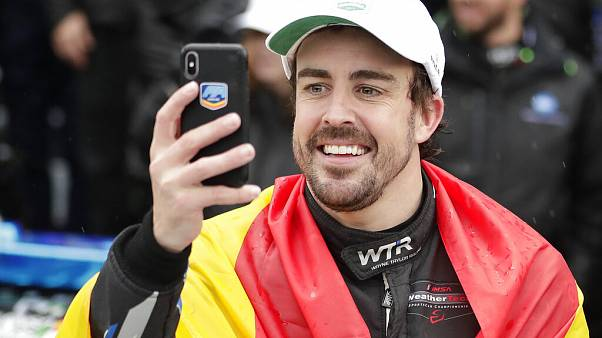 Fernando Alonso, of Spain, takes a selfie photo in Victory Lane after winning the 24 hour race at Daytona International Speedway, 2019