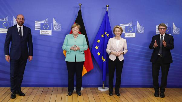 Charles Michel, Angela Merkel, Ursula von der Leyen and David Sassoli pose for photographers prior to a meeting at EU headquarters in Brussels.