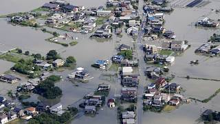 This aerial photo shows the flooded area caused by the swollen Chikugo River, not seen in photo, in Kurume city