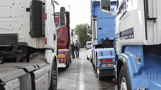 Truckers gather to perform a 'drive slow' action to Brussels at a tank station in Waarloos, Belgium on Monday, Sept. 24, 2012.