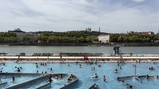People visit a swimming pool in the center of Lyon, central France, Tuesday, June 25, 2019.
