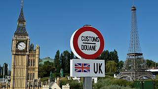 A model of a customs road sign is seen at the mock EU-UK border, with a model of Big Ben and the Eiffel Tower, at a 'Mini-Europe' theme park  in Brussels on May 20, 2020.