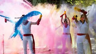 Pro-animal rights activists spread powder to celebrate the cancellation of this year's San Fermin Festival's bullfights and bull-running during a demonstration in Pamplona