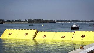 Moveable flood gates rise from the sea in the Venice lagoon, Italy, Friday, July 10, 2020.