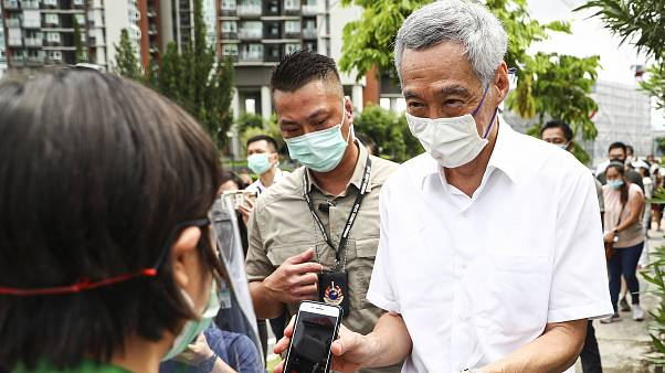 People's Action Party Secretary-General and Singaporean Prime Minister Lee Hsien Loong, arrives to vote in Singapore's general election, Friday, July 10, 2020.