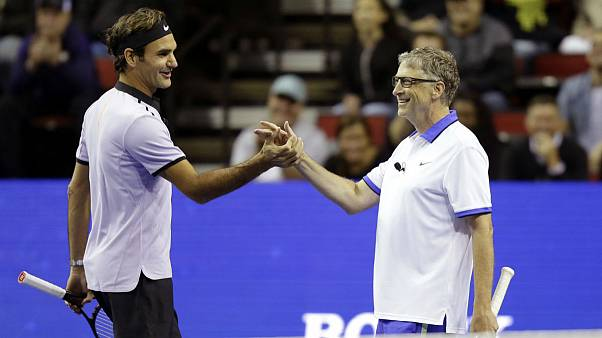 Roger Federer, of Switzerland, left, and Microsoft founder Bill Gates, right