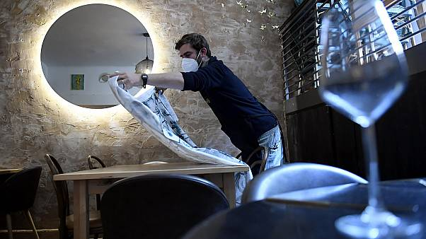 A Hungarian restaurant owner prepares to open in Budapest.