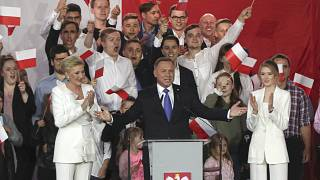 Incumbent President Andrzej Duda, center, gestures next to his wife Agata Kornhauser-Duda