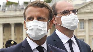 File: France's President Emmanuel Macron, left, and France's Prime Minister Jean Castex, wear face mask, at the end of the Bastille Day military parade, Paris. July 14, 2020.