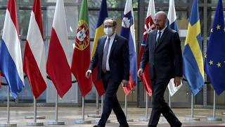 European Council President Charles Michel, right, walks with Kosovo's Prime Minister Avdullah Hoti before a meeting in Brussels in June