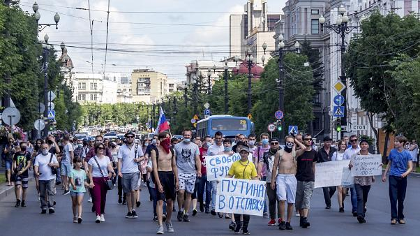 """""""Freedom for Sergei Furgal"""" and """"Putin to Resign!"""" seen on posters during an unsanctioned protest on Sunday to support Sergei Furgal, Khabarovsk governor"""