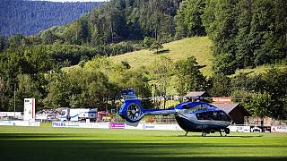 A police helicopter stands on a sports field in Oppenau, southern Germany.