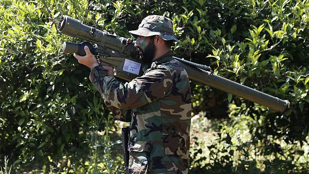 Photo, shows a Hezbollah fighter holding an Iranian-made anti-aircraft missile on the border with Israel, in Naqoura, south Lebanon