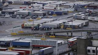 Lorries leave after disembarking a ferry as others wait to board on the morning after Brexit, Saturday Feb 1, 2020.