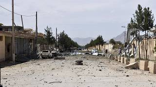Afghan security personnel inspect the site of a car bomb blast on an intelligence compound in Aybak, northern Afghanistan, Monday, July 13, 2020.