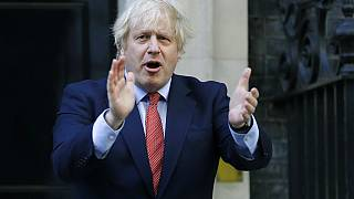 PM Boris Johnson applauds health and care workers during the UK's COVID-19 outbreak