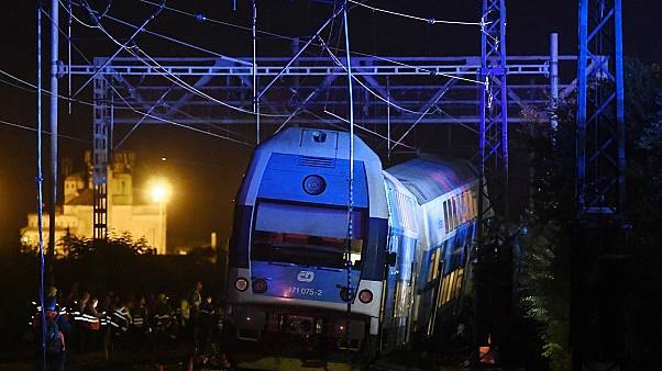 Rescuers work at the scene of a passenger and freight trains collision in Cesky Brod, east of Prague,