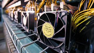 Archive image: Fans used to cool Bitcoin data miners are hooked up on the miners during construction of a Bitcoin data centre in Virginia Beach, Virginia
