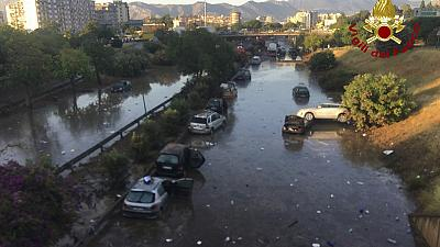 Dozens swim to safety after floods trap cars in Palermo underpass