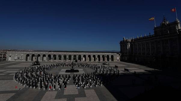 A tribute was held for COVID-19 victims at Madrid's Royal Palace