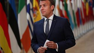 French President Emmanuel Macron makes a statement as he arrives for an EU summit at the European Council building in Brussels, Friday, July 17, 2020.