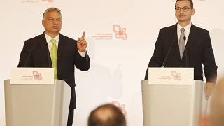 Hungarian Prime Minister Viktor Orban,left, speaks at a join news conference with Poland's Prime Minister Mateusz Morawiecki,right, Jul 3 2020