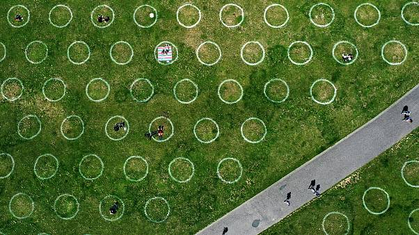 An aerial view shows painted circles for social distancing at the Rhine promenade in Dusseldorf, Germany. July 12, 2020