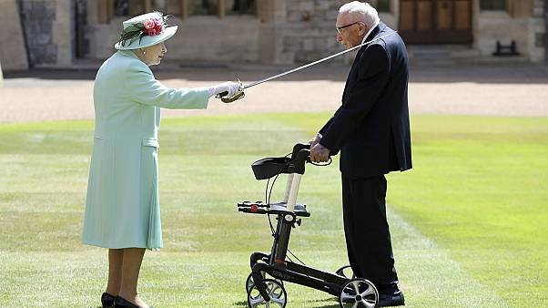 Captain Sir Tom Moore receives his knighthood from Her Majesty the Queen at Windsor.