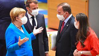 German Chancellor Angela Merkel and French President Emmanuel Macron speak with Sweden's Prime Minister Stefan Lofven and Finland's Prime Minister Sanna Marin