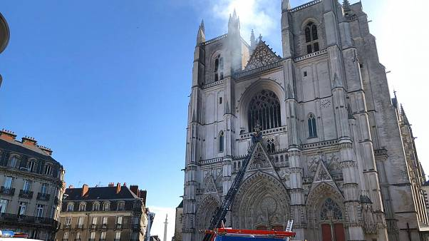 Fire fighters brigade work to extinguish the blaze at the Gothic St. Peter and St. Paul Cathedral, in Nantes, western France, Saturday, July 18, 2020