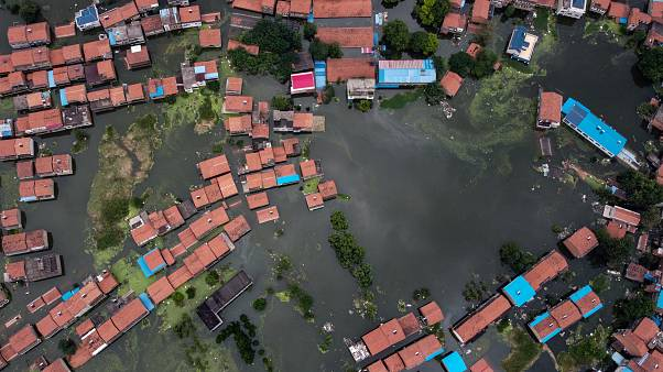 An aerial view shows flooded residential buildings due to rising water levels of the Yangtze river in Jiujiang, China's central Jiangxi province.