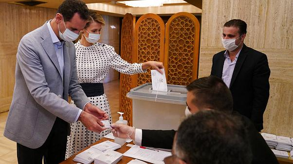 Syrian President Bashar Assad and his wife Asma vote at a polling station in the parliamentary elections in Damascus, Syria
