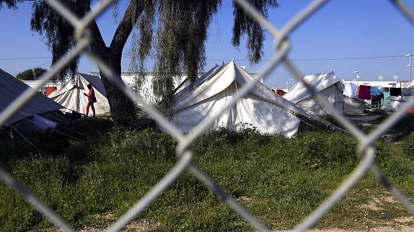A migrant walks by the tents inside a refugee camp in Kokkinotrimithia outside of Nicosia, Cyprus, Tuesday, March 3, 2020.