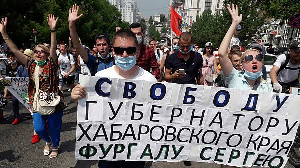 """People hold posters reading """"Freedom for Khabarovsk region's governor Sergei Furgal"""" during an unsanctioned protest in Khabarovsk, Russia. July 18, 2020."""
