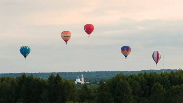 Hot air balloons fill the sky after three month delay to festival