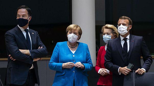 From left, Dutch Prime Minister Mark Rutte, German Chancellor Angela Merkel, European Commission President Ursula von der Leyen and French President Emmanuel Macron during a m